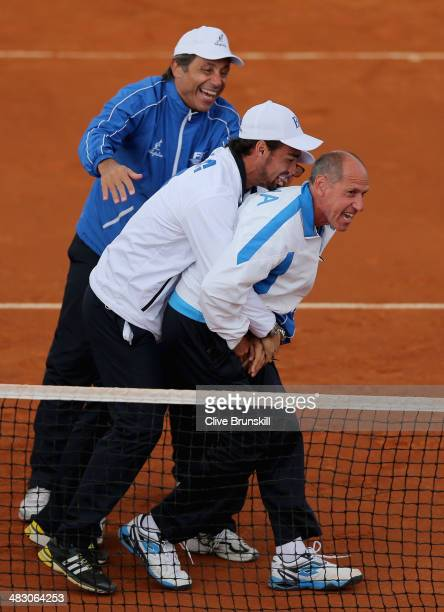 Italian team captain Corrado Barazzutti is grabbed by Fabio Fognini after Andreas Seppi of Italy has won the fifth and decisive rubber against James...