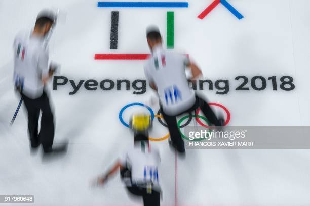 TOPSHOT Italian team competes during the curling men's round robin session between Canada and Italy at the Pyeongchang 2018 Winter Olympic Games at...