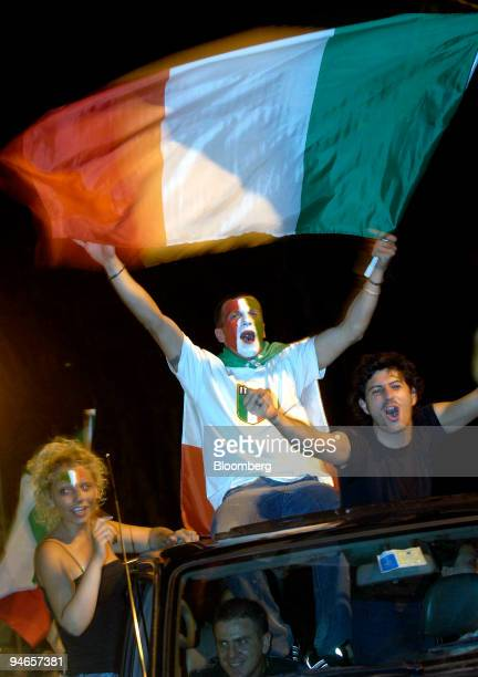 Italian team fans celebrate in the streets of Milan Italy early in the morning of Monday July 10 after the Italian national soccer team won the 2006...