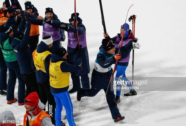 TOPSHOT Italian team members form an honour guard as they celebrate Italy's Federico Pellegrino second place silver medal win in the men's...