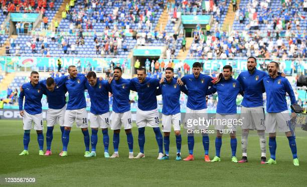 Italian team sing their national anthem during the UEFA Euro 2020 Championship Group A match between Italy and Wales at Olimpico Stadium on June 20,...