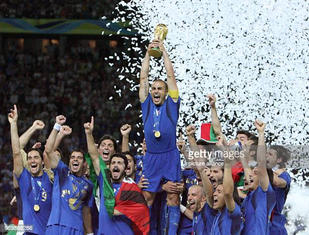 Italian team with captain Fabio Cannavaro celebrates with the World Cup during the ceremony after the final of the 2006 FIFA World Cup between Italy...