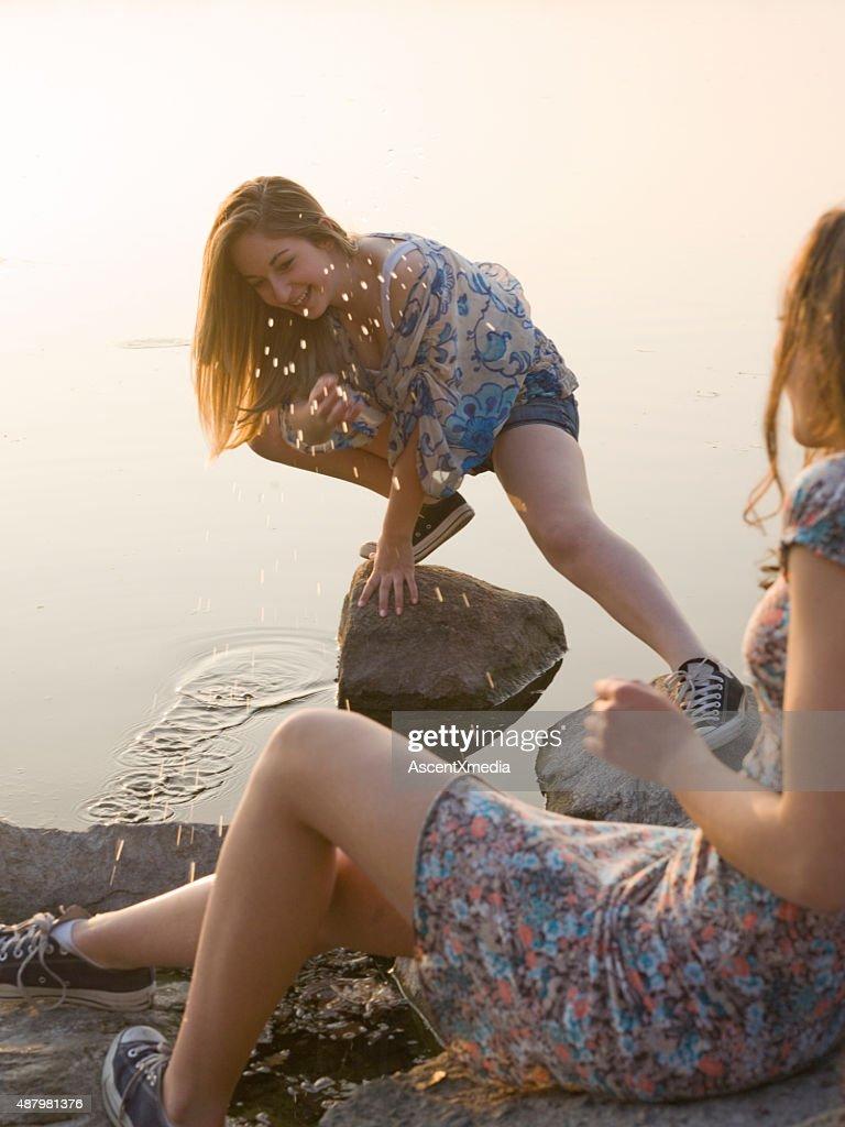 Italian Teenage Girls Splash Each Other By Lakeshore Stock Photo