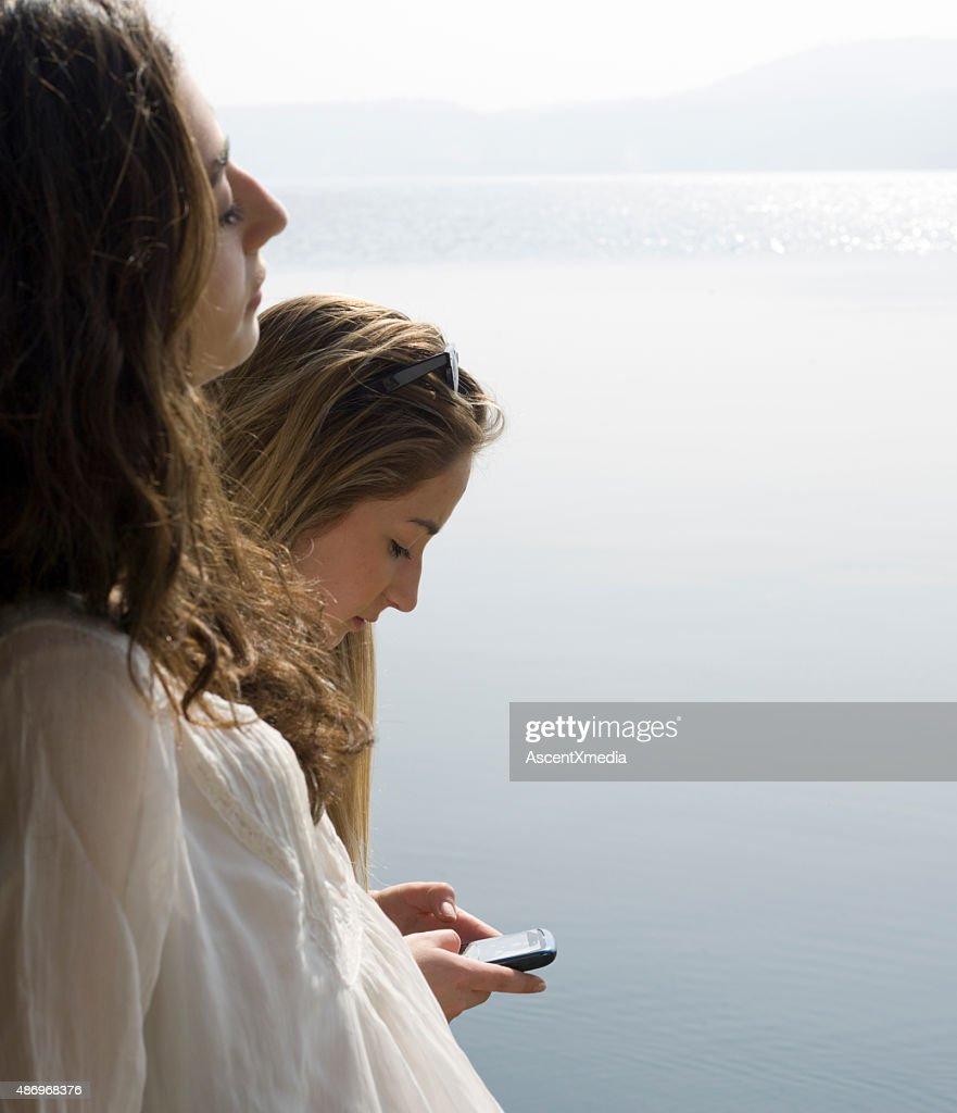 Italian Teenage Girls Stand Beside Lake Send Text Stock Photo