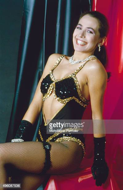 Italian television host and actress Barbara D'Urso posing smiling for a photo shoot wearing a stage costume nylon stockings and gloves Italy 1981