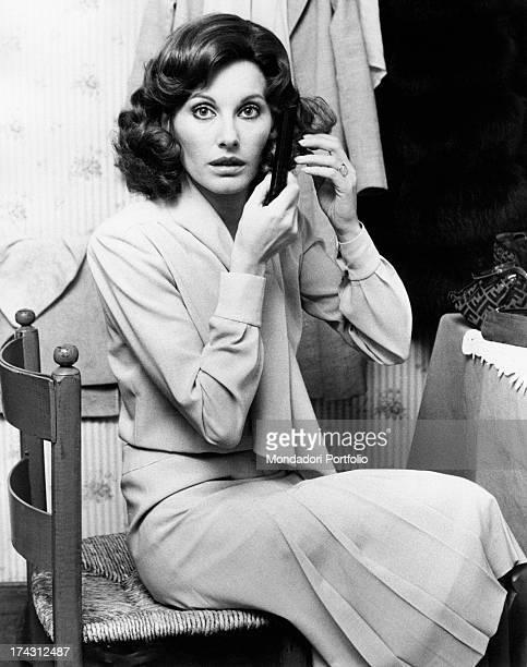 Italian television presenter and actress Gabriella Farinon fixing her hair Rome 1970s