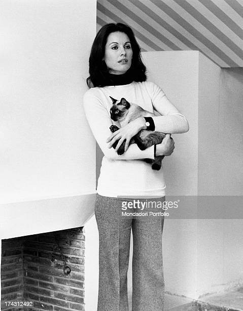 Italian television presenter and actress Gabriella Farinon holding a cat in her arms Rome 1970s