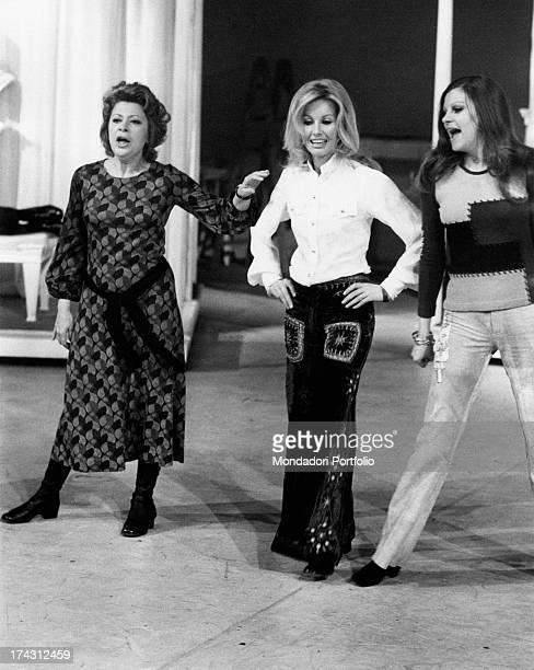 Italian television presenter and actress Gabriella Farinon Italian singer and actress Milva and Italian comic actress Maria Bice Valori dancing and...