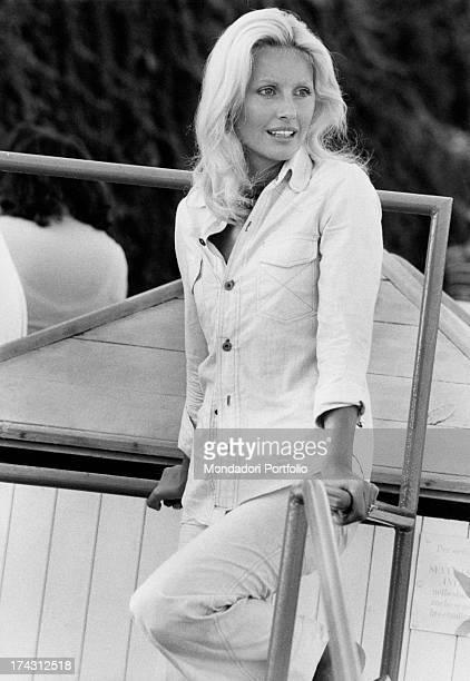 Italian television presenter and actress Gabriella Farinon leaning on a handrail Gaeta 1970s