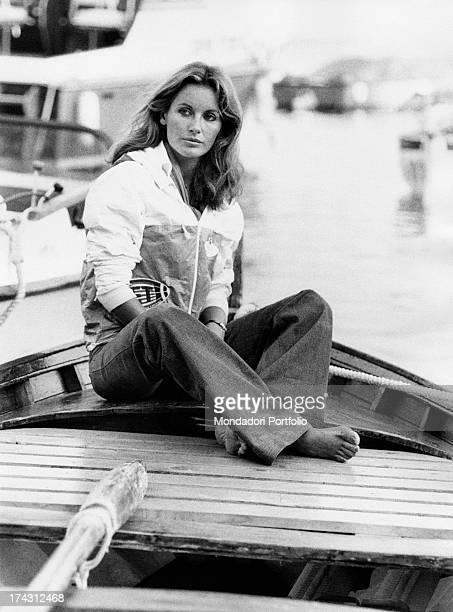Italian television presenter and actress Gabriella Farinon sitting on a boat 1970s