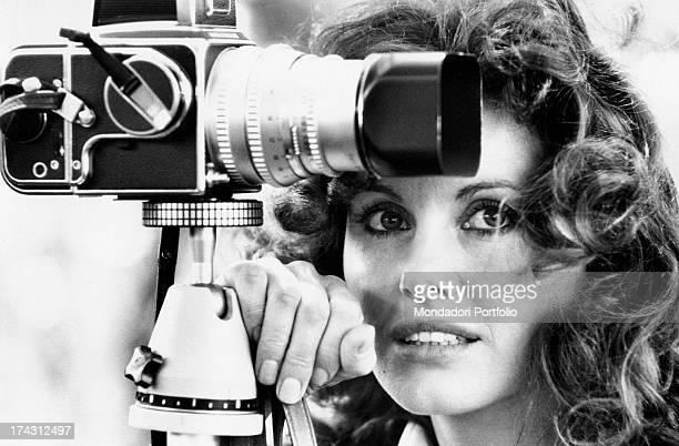 Italian television presenter and actress Gabriella Farinon smiling near a camera Rome 1970s