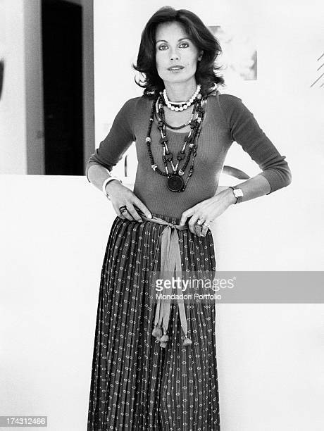 Italian television presenter and actress Gabriella Farinon smiling with her hands on her hips Rome 1970s