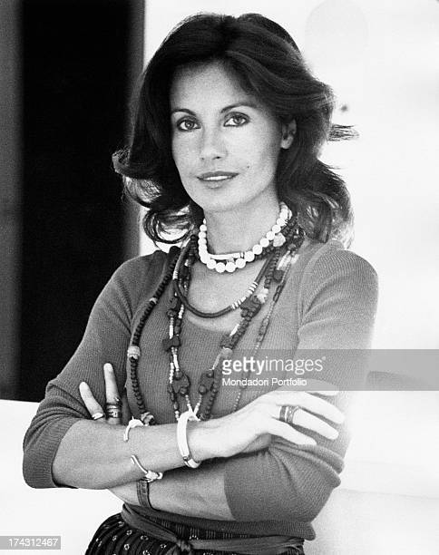 Italian television presenter and actress Gabriella Farinon smiling with folded arms Rome 1970s