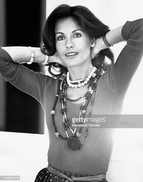 Italian television presenter and actress Gabriella Farinon smiling with her arms behind her head Rome 1970s