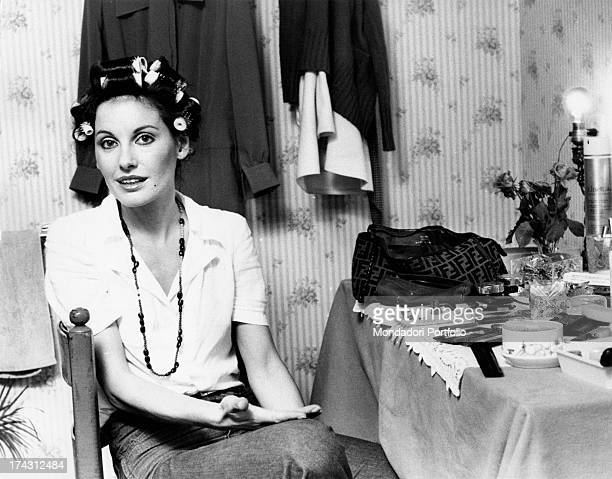 Italian television presenter and actress Gabriella Farinon talking sitting with hair curlers in her hair Rome 1970s