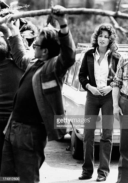 Italian television presenter and actress Gabriella Farinon watching a gardener working Rome 1970s