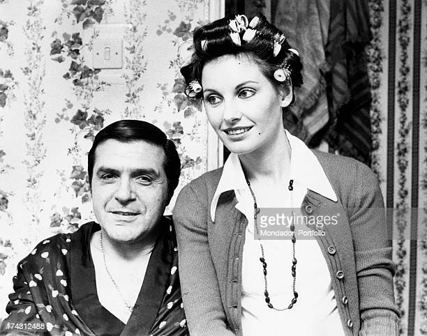 Italian television presenter and actress Gabriella Farinon with hair curlers in her hair sitting beside Italian actor and dubber Aldo Giuffrè Rome...