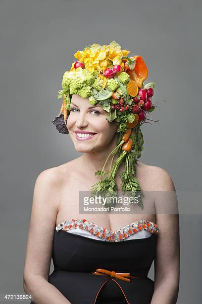 'Italian television presenter Antonella Clerici posing smiling with a hat made of fruit and vegetables Rome 4th April 2013 '