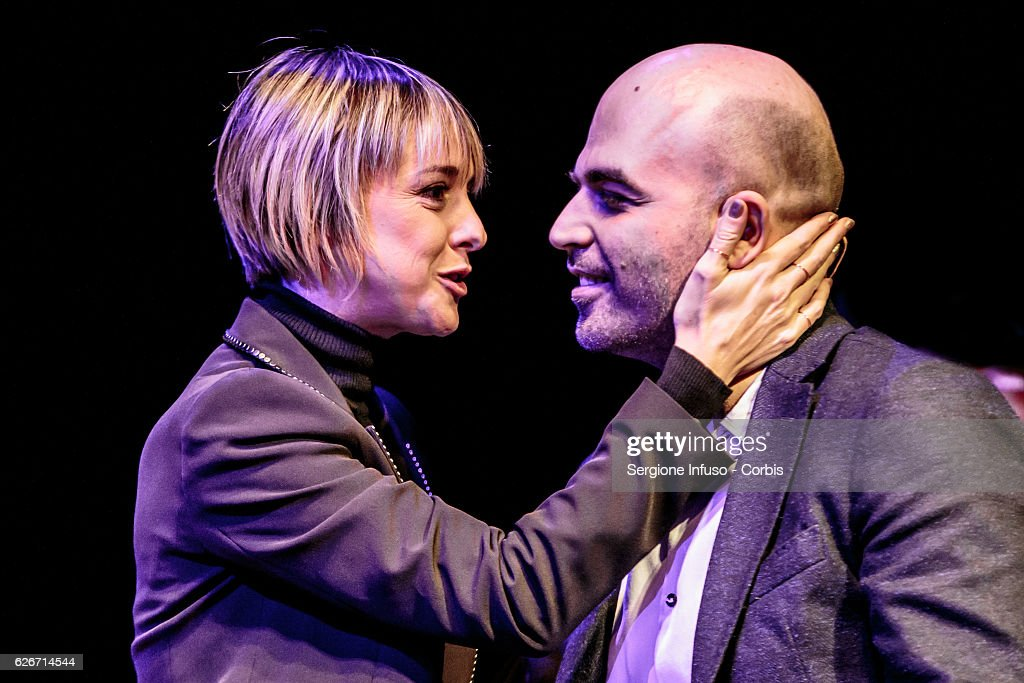 Italian television presenter Nadia Toffa (L) is a guest of the show 'Sottosopra': Roberto Saviano (R) Meets The Audience on November 28, 2016 in Milan, Italy.