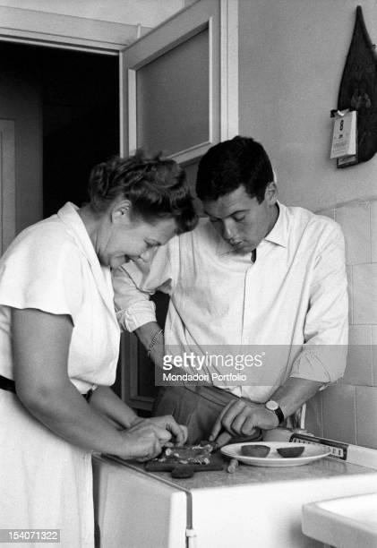 Italian tennis champion Nicola Pietrangeli helps his mother Russian Anne de Yorgainge preparing a particular dish 1956
