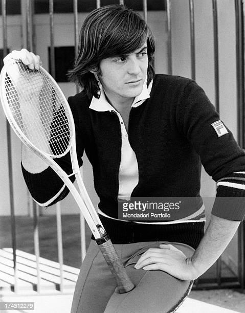 Italian tennis player Adriano Panatta holding a tennis racket Rome 1974