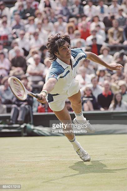 Italian tennis player Adriano Panatta pictured competing to reach the third round of the Men's Singles tournament at the Wimbledon Lawn Tennis...