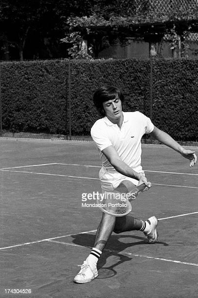 Italian tennis player Adriano Panatta playing tennis 1960s