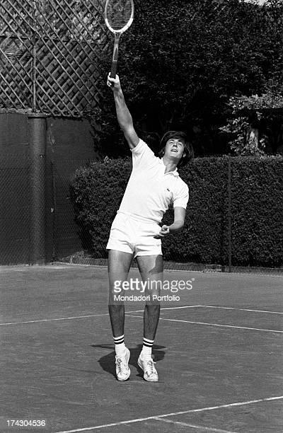 Italian tennis player Adriano Panatta replying with a smash playing tennis 1960s