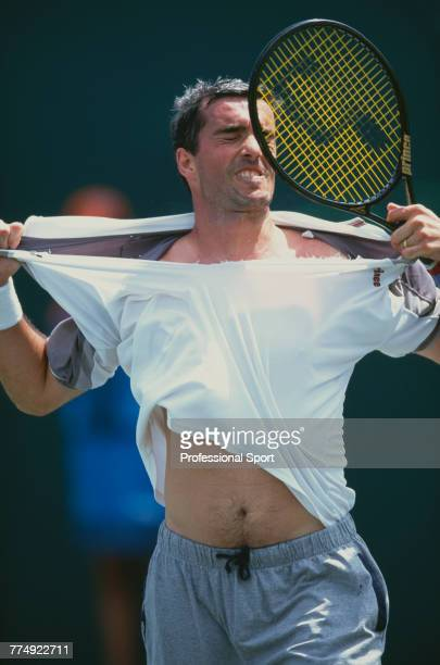 Italian tennis player Davide Sanguinetti pictured in action to lose to French tennis player Fabrice Santoro in the first round of the Men's Singles...