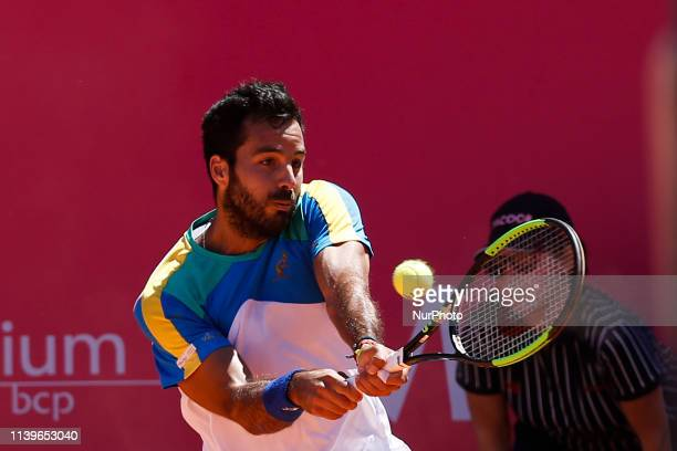Italian tennis player Salvatore Caruso returns the ball to Spanish player Pedro Martinez during their Millennium Estoril Open ATP Singles Qualifying...