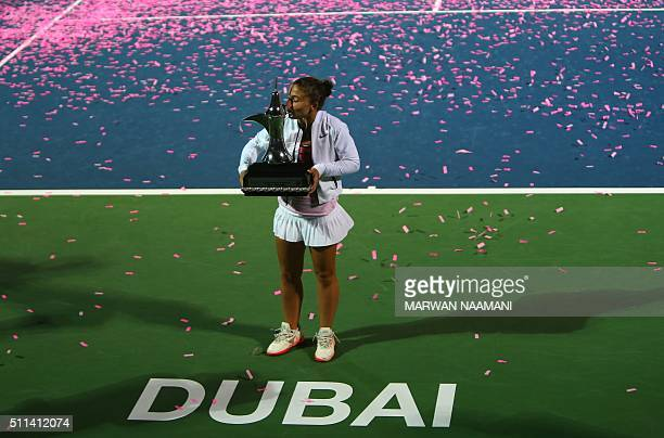 TOPSHOT Italian tennis player Sara Errani kisses the winner's trophy after beating Czech player Barbora Strycova in the final WTA tennis match of the...