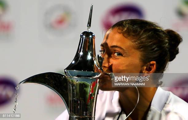 Italian tennis player Sara Errani kisses the winner's trophy after beating Czech player Barbora Strycova in the final WTA tennis match of the Dubai...