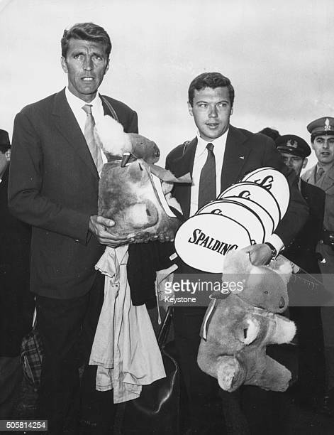 Italian tennis players Nicola Pietrangeli and Orlando Sirola arriving back home holding toy koala bears after making the final of the Davis Cup in...