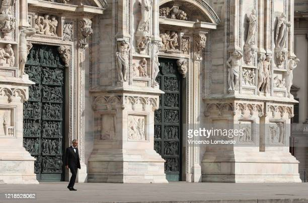 Italian tenor and opera singer Andrea Bocelli rehearses outside the Duomo cathedral on a empty Duomo square prior to an evening performance without...