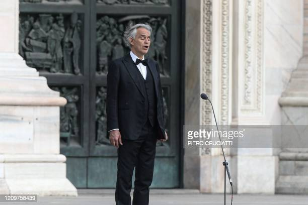 TOPSHOT Italian tenor and opera singer Andrea Bocelli sings during a rehearsal on a deserted Piazza del Duomo in central Milan on April 12 prior to...