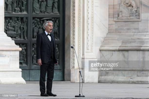 Italian tenor and opera singer Andrea Bocelli sings during a rehearsal on a deserted Piazza del Duomo in central Milan on April 12 prior to an...