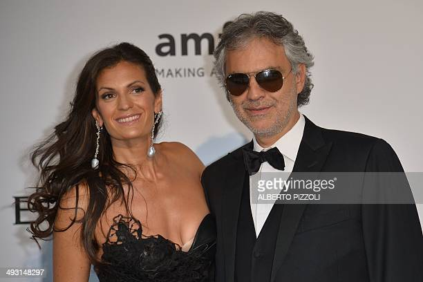 Italian tenor Andrea Bocelli and his wife Veronica Berti pose as they arrive for the amfAR 21st Annual Cinema Against AIDS during the 67th Cannes...