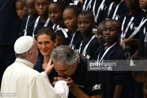 Italian tenor Andrea Bocelli greets Pope Francis as members of the Andrea Bocelli Foundation 'Voices of Haiti' choir look on during the weekly...