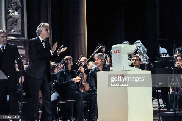 Italian tenor Andrea Bocelli greets the robot after performing on stage with Robotic Orchestra conductor Yumi and the Orchestra Filarmonica di Lucca...