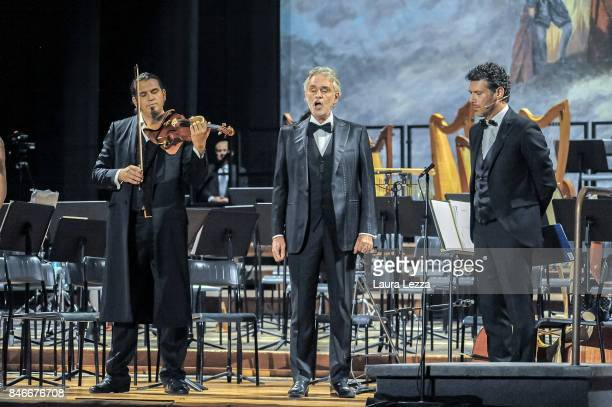 Italian tenor Andrea Bocelli perform on stage with violinist Brad Repp and actor Renato Raimo Teatro Verdi on September 12 2017 in Pisa Italy For the...