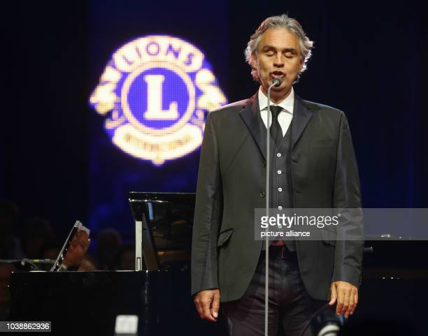 Italian tenor Andrea Bocelli performes after having received the Humanitarian Award 2013 of the secular service organization Lions Clubs...