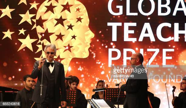 Italian tenor Andrea Bocelli performs during the Global Teacher Prize ceremony in Dubai on March 19 2017 Canadian teacher Maggie MacDonnell who works...