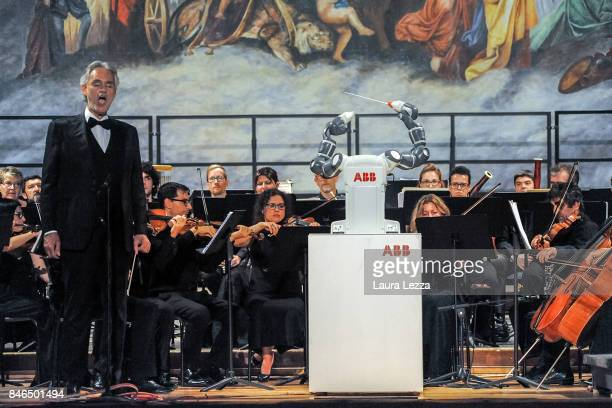 Italian tenor Andrea Bocelli performs on stage with Robotic Orchestra conductor Yumi on September 12 2017 in Pisa Italy For the first time ever a...