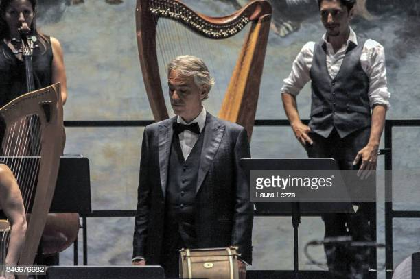 Italian tenor Andrea Bocelli performs on stage with Robotic Orchestra conductor Yumi and the Orchestra Filarmonica di Lucca at Teatro Verdi on...