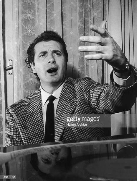 Italian tenor Franco Corelli singing at the piano at his home in Milan.