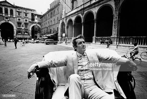 Italian tenor Franco Corelli sitting on a coach. Verona, July 1970