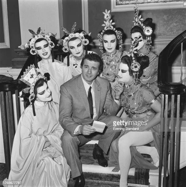 Italian tenor Franco Corelli with a group of performers from the Puccini opera 'Turandot', UK, 18th May 1966.