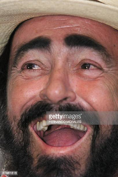 Italian tenor Luciano Pavarotti sings his national anthem during the inauguration of an education center in San Lucas Toliman 140kms south of...