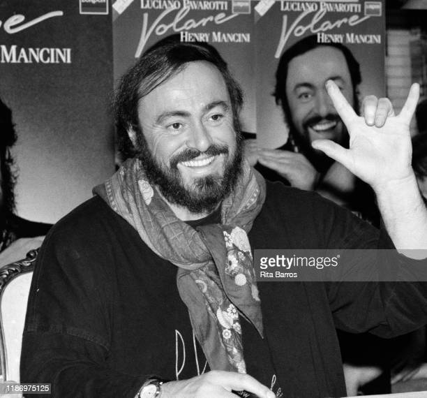 Italian tenor Luciano Pavarotti smiles during a signing of his album 'Volare' held at a Sam Goody record store New York New York December 2 1987