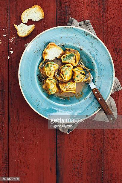 Italian tortelloni with meat and demi-glace sauce
